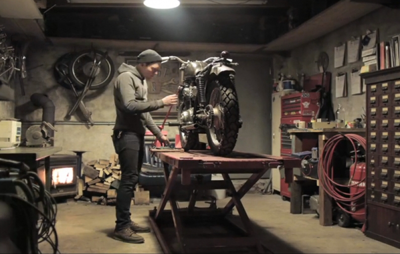 motorcycle builder guy tinkering